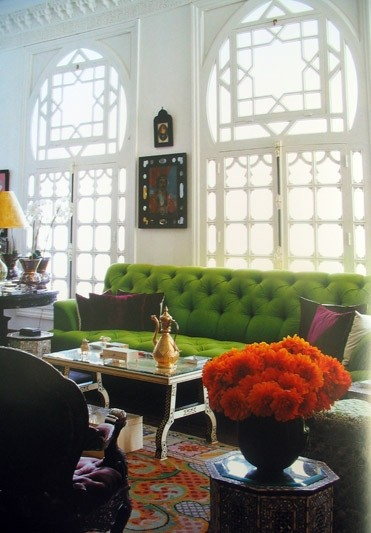 I love the detail of the windows and the bold green sofa.